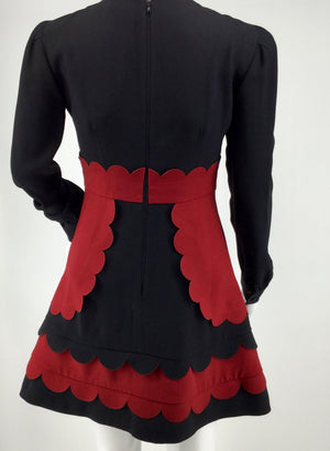 APPAREL,DRESSWEAR - AMAZING  RED VALENTINO DRESS. GREAT SCALLOPED DESIGN IN MAROON AND BLACK. VERY CHIC AND TRENDY DRESS. THIS IS THE SAME DRESS CHARLOTTE RITCHIE WORE TO THE TV AWARDS IN LONDON.  RETAIL IS OVER $900.00