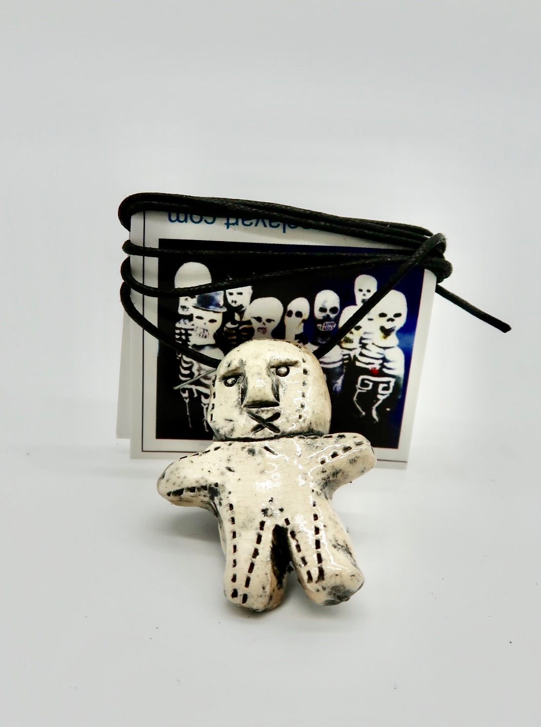 """Voodoo Doll Necklace"" by Joy Gauss"