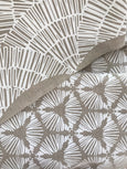 fan white on oatmeal greige textiles