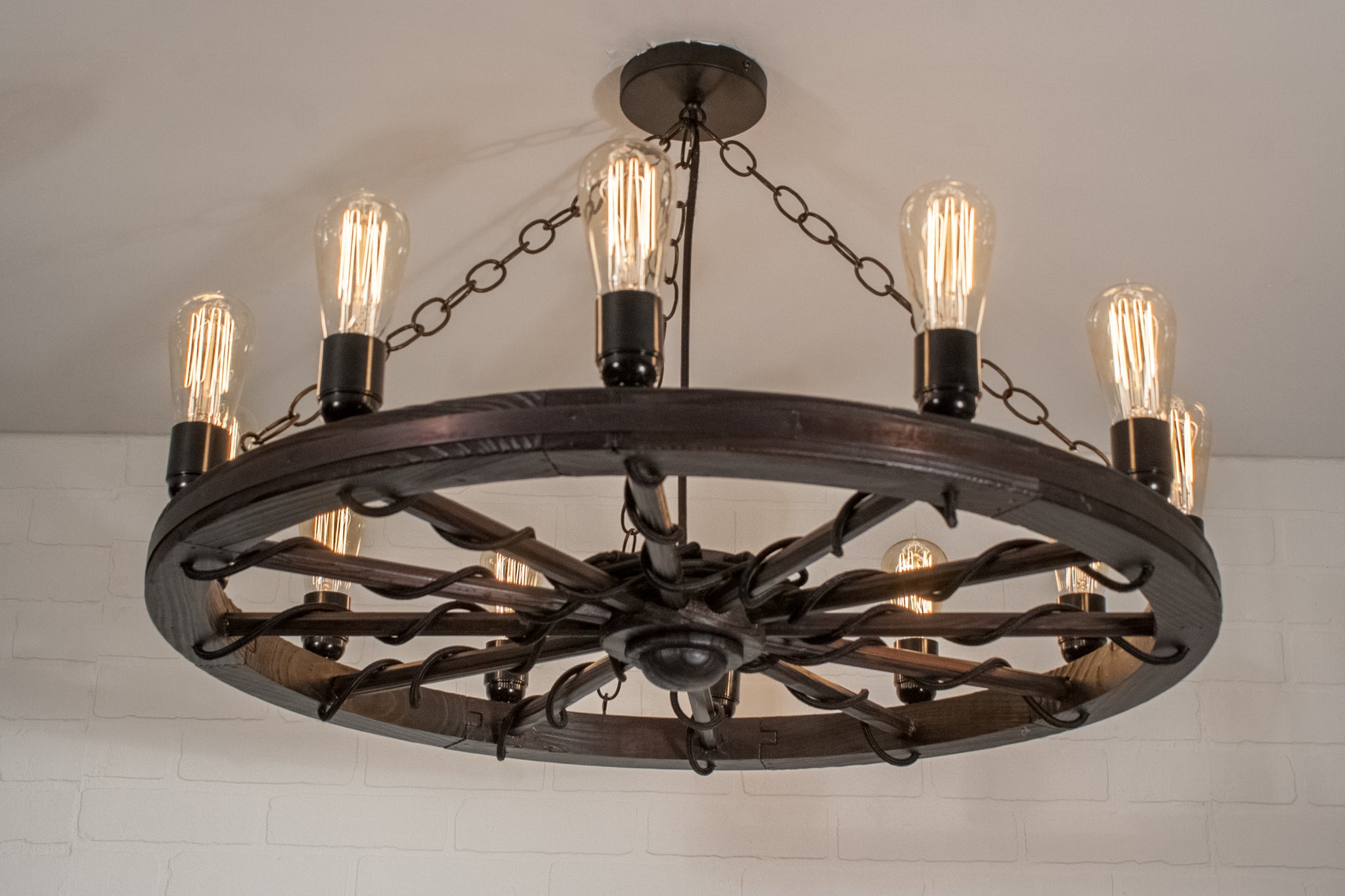 large farmhouse light with wagon wheel