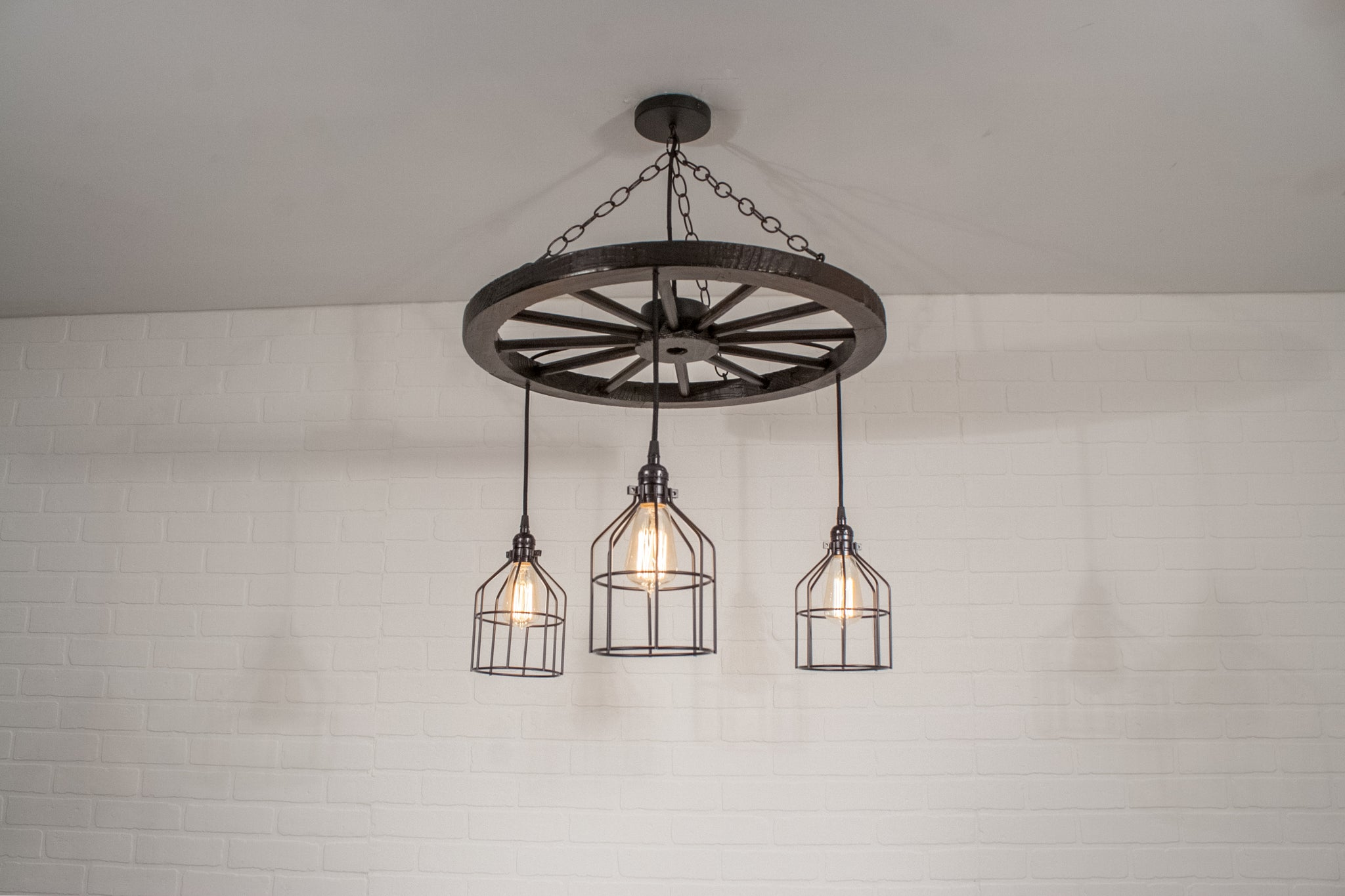 rustic wagon wheel light fixture with cages