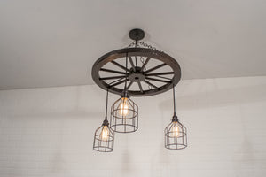 rustic light fixture on a wagon wheel