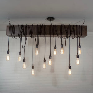 Wood Beam with 12 Edison Pendant Lights - Loewen Design Studios
