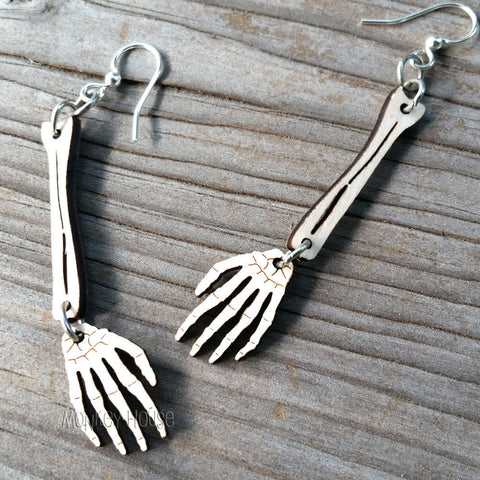 skeleton hands laser cut wood earrings by green tree jewelry