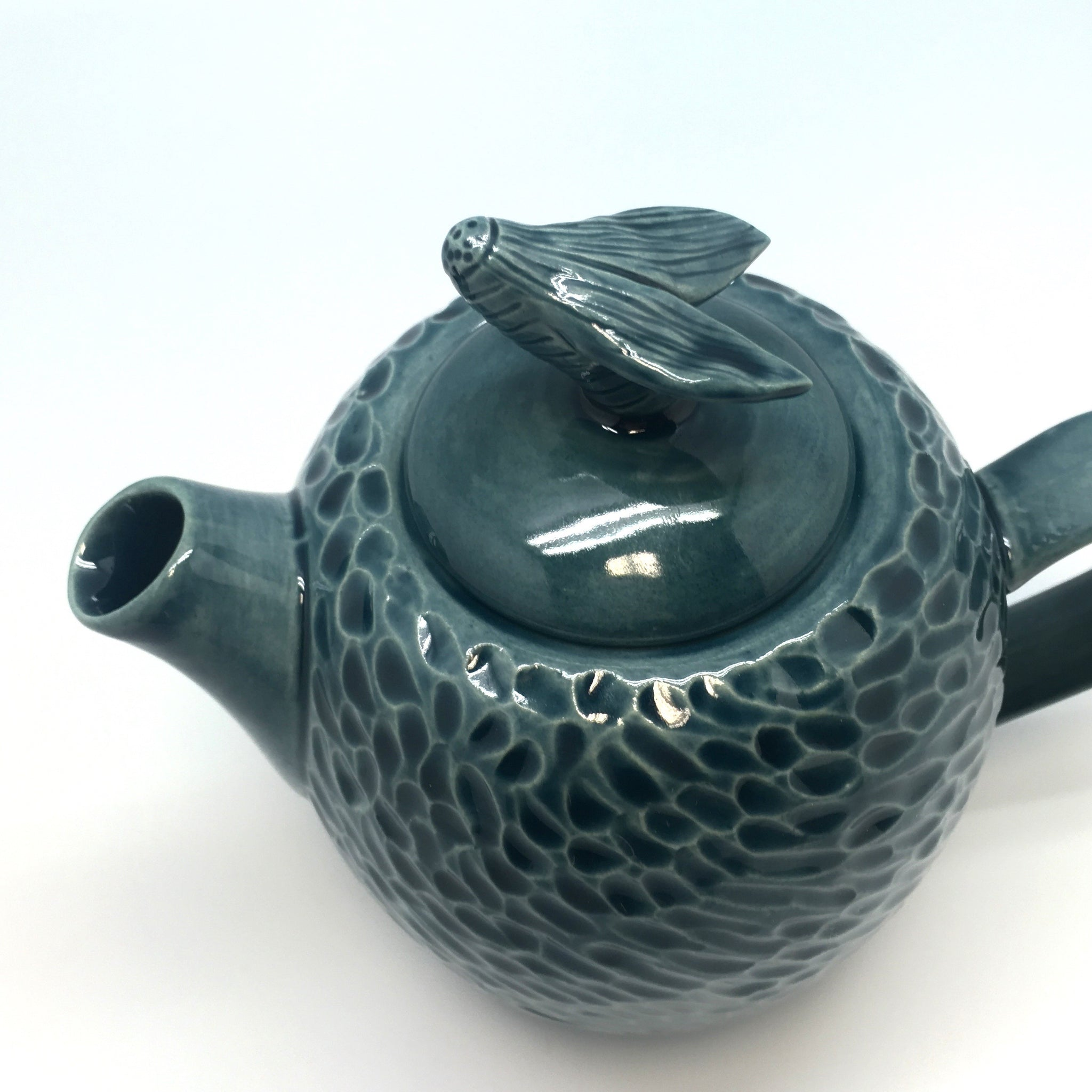 A small storm coloured teapot