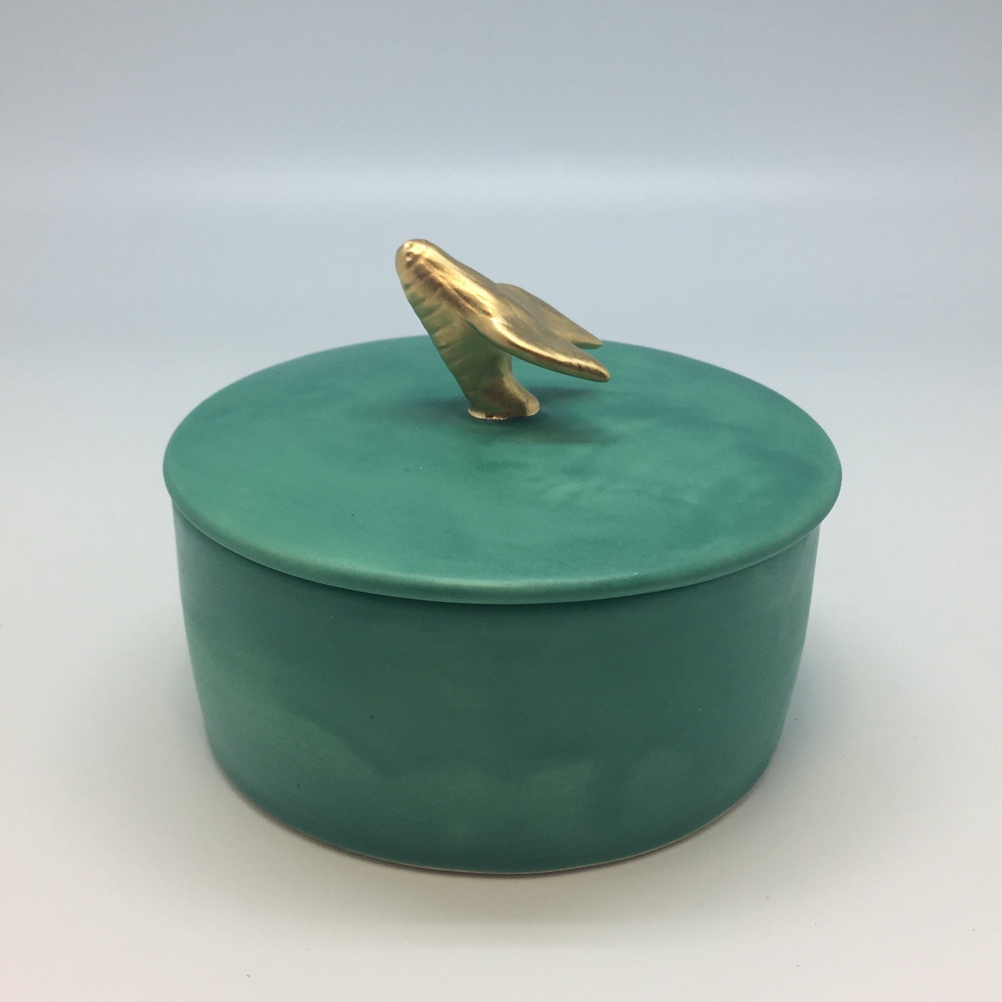 Emerald green jewlery box with a golden bug