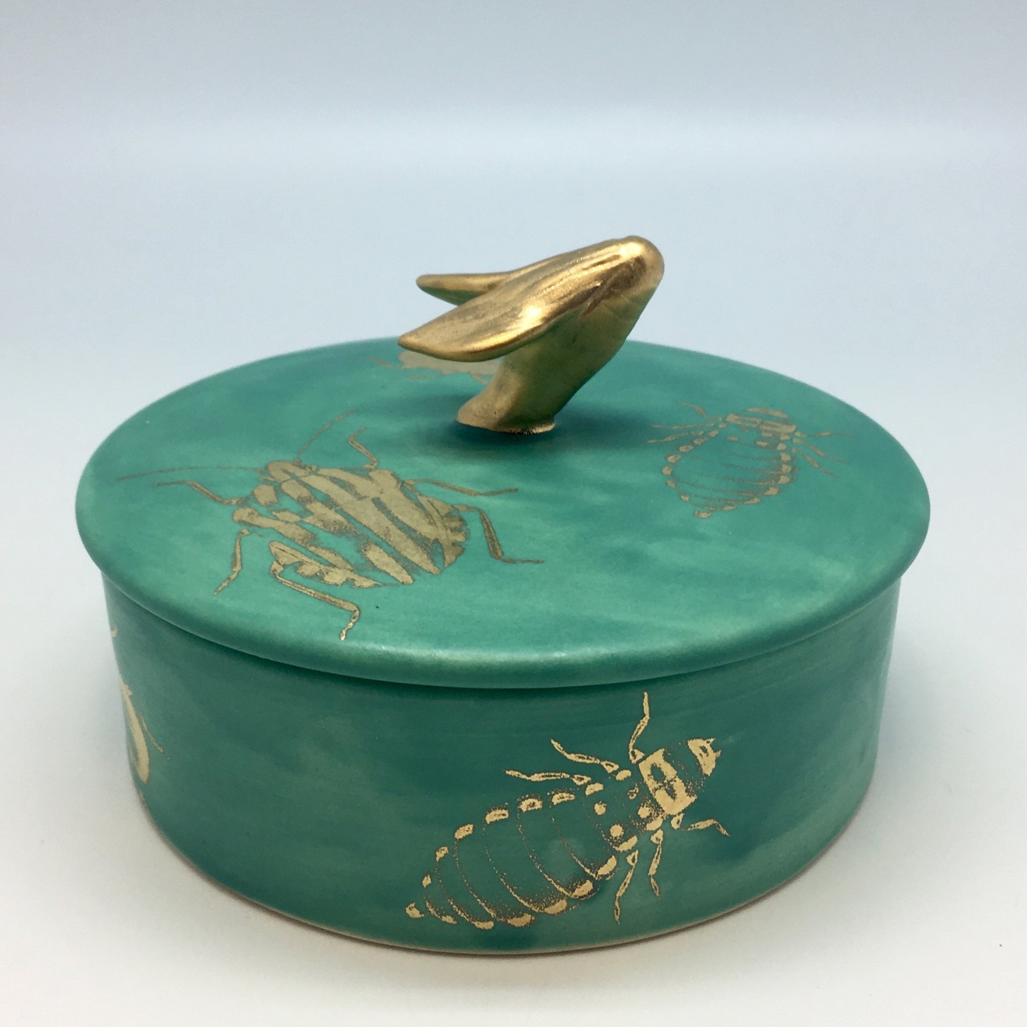 Emerald green jewlery box with golden bugs