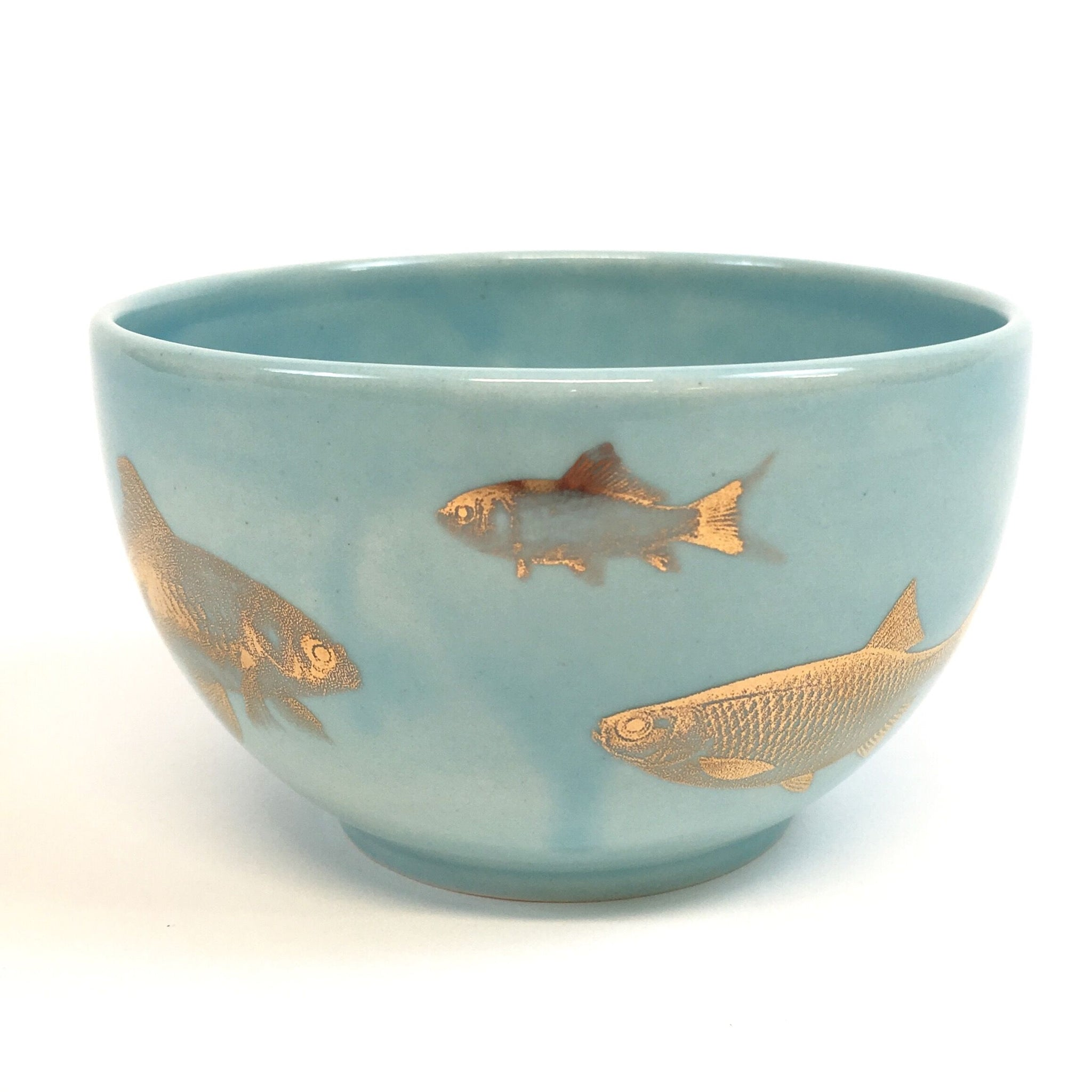 Light blue bowl with golden fish