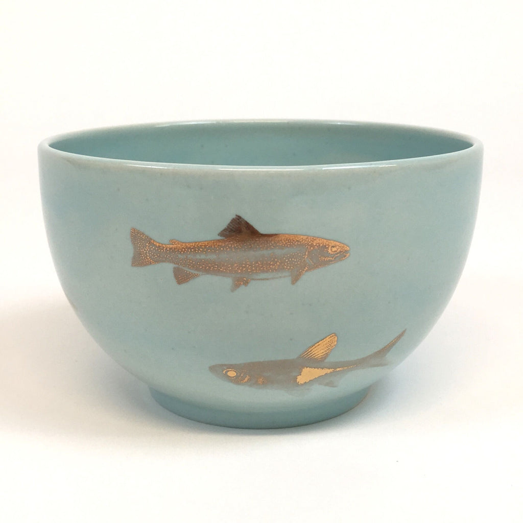 Light turquoise bowl with golden fish