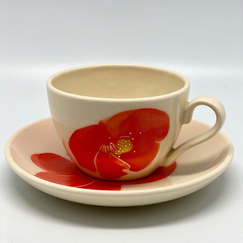 A tea-and coffee cup with a saucer