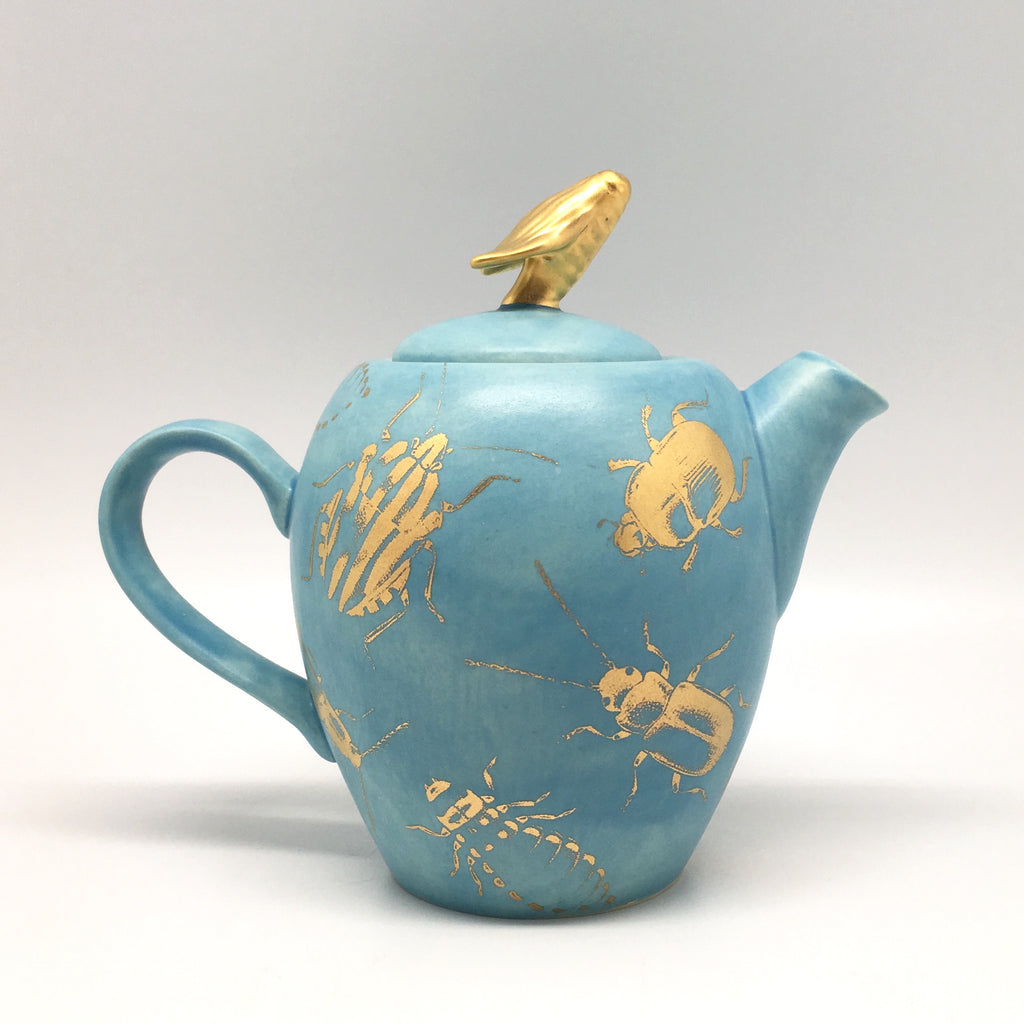 Silky blue teapot with golden bugs