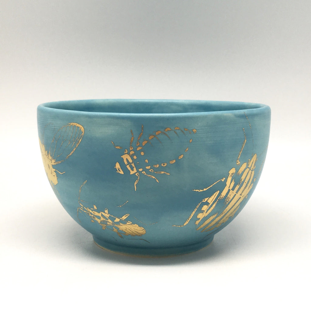 Silky blue bowl with golden bugs