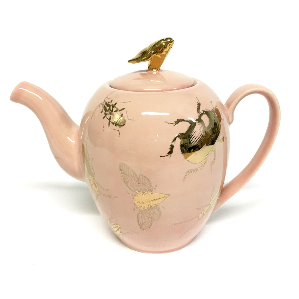 Big pink teapot with bugs