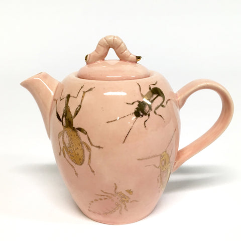 A small powder pink teapot