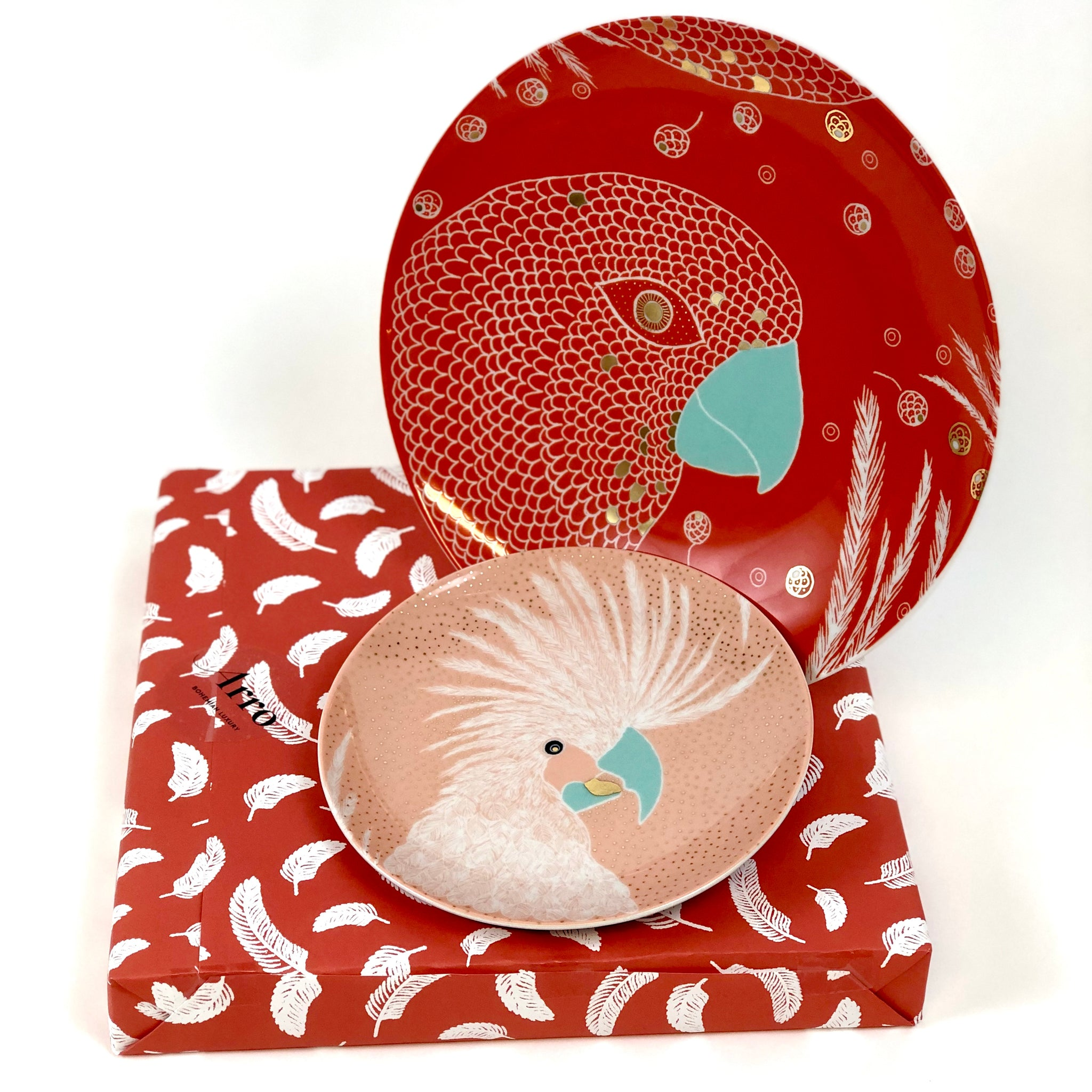 Giftwrapped red dinner plate and pink dessert plate