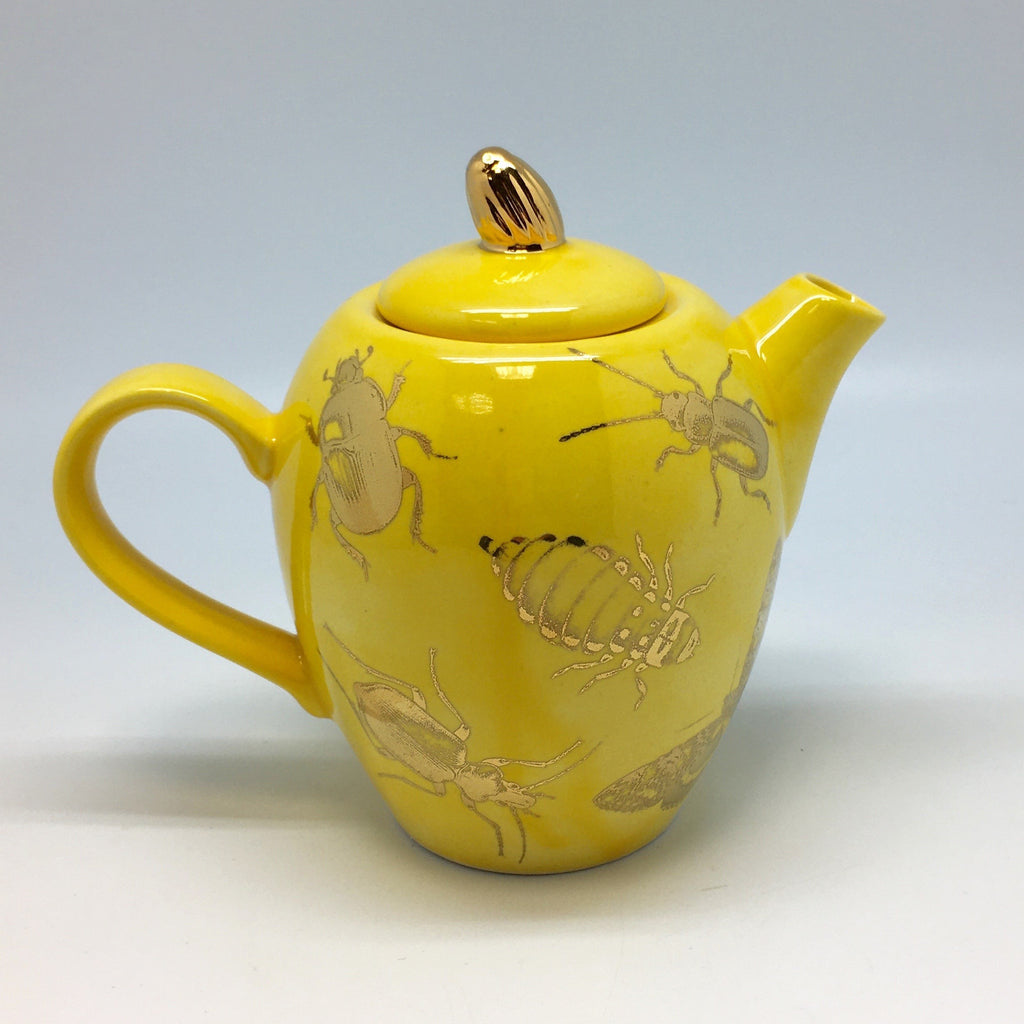 Dandelion yellow teapot with a golden bug