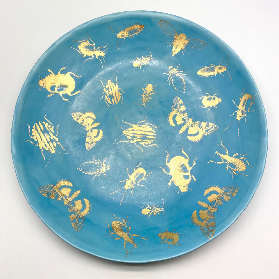 Silky matte blue platter with golden bugs