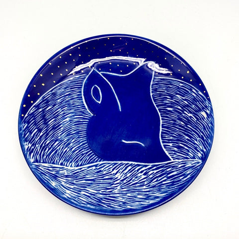 A small plate with a small fox