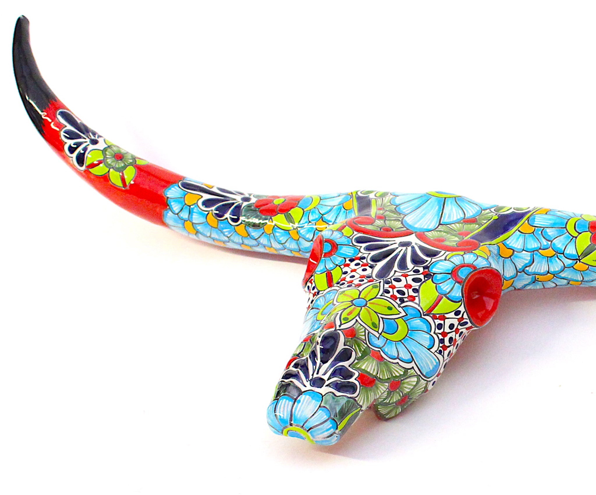 Wall hanging cow skull sculpted from ceramic artisan painted with Talavera patterns. Talavera pottery.