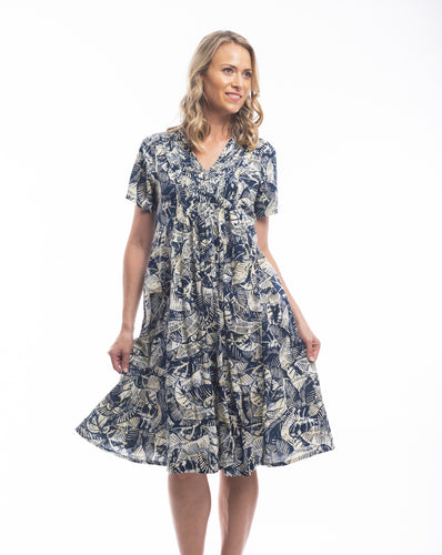 When it comes to the brand Orientique it's all about colour, detail and comfort while still looking modern and stylish. Made from 100% Rayon this dress is ideal for those hot summer days. Featuring a V-Neck with pleats across the front flowing loosely to a relaxed body, the tropical print in a subtle mix of navy and creams will have you dreaming of summer and paradise.