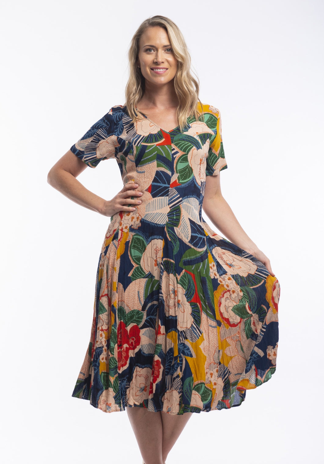 When it comes to the brand Orientique it's all about colour, detail and comfort while still looking modern and stylish. The Costa Brava Godet Dress is inspired by the colours and motifs of the Caribbean. Bold graphic florals in bright tones. Made from 100% Rayon it's soft and cool for those hot summer days.