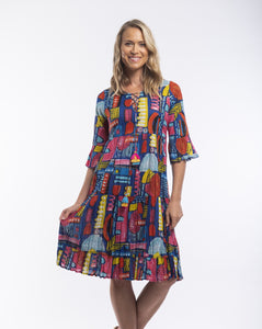 When it comes to the brand Orientique it's all about colour, detail and comfort while still looking modern and stylish. The Catalonia Ruffle Dress is inspired by the fun and vibrance of POP art. Featuring a criss cross neckline and fluted 3/4 sleeves the splashes of colour and fun print is sure to impress. Made from 100% Cotton it's soft and cool for those hot summer days.