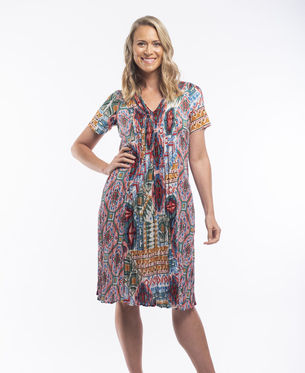 When it comes to the brand Orientique it's all about colour, detail and comfort while still looking modern and stylish. Featuring a V-Neck with pin tucked pleats across the front, loosely flowing to a relaxed body, the colourful eye catching Aztec print will have you dreaming of Summer and paradise. Made from 100% Crinkle Cotton this dress is ideal for those hot summer days.