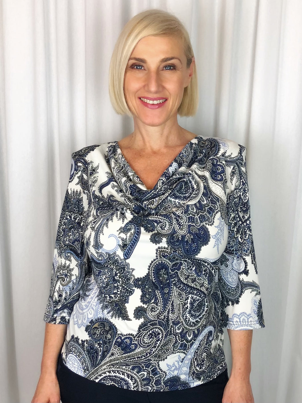 Our 3/4 Sleeve Paisley Cowl Neck is an elegant top for any time of day. Featuring a dramatic design in navy, blue and neutral tones with details of puff paint that compliment the style. Made in Australia from Poly/Spandex, it's fully washable and drips dry with no ironing required.