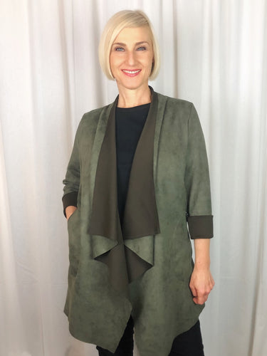 Soft and luxurious our Faux Suede Waterfall Jacket is the ideal piece to throw on for Autumn/Winter. Available in two rich shades - Olive and Denim, it features softly draped oversized lapels, full length sleeves that can be folded to a 3/4 length and side zip pockets. Made from Polyester Spandex this jacket is lightweight, warm and fully washable.