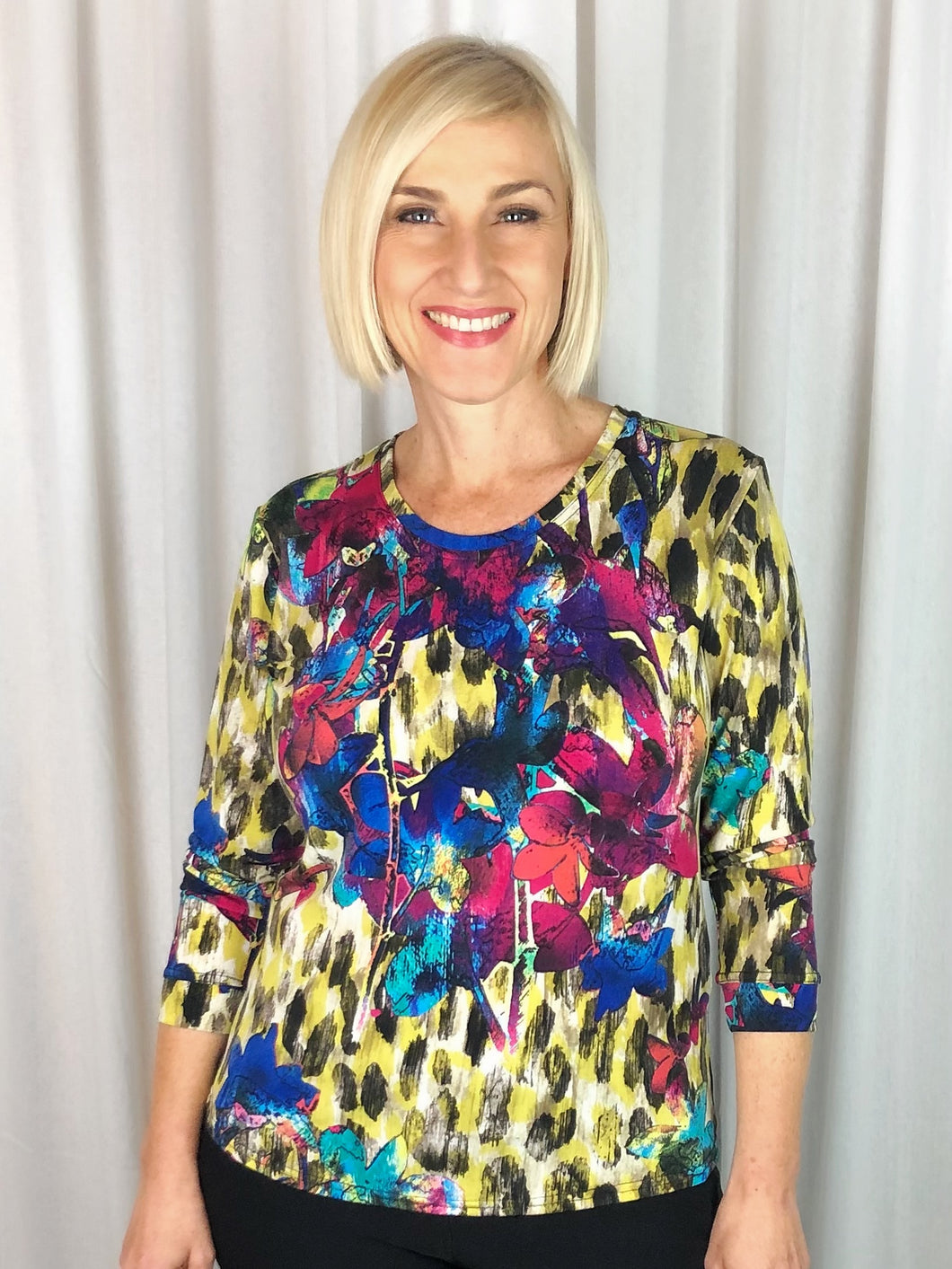 Sophisticated and elegant! Our Long Sleeve Garden Top made from a luxurious slinky jersey features a floral design in gold, royal and fuchsia tones. This stylish print looks great on its own or team it with a jacket in a co-ordinating colour to make it pop. Made in Australia from Polyester Spandex it washes and drip dries with no ironing required.