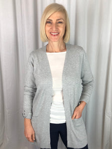 Classic in style, our Longline Knit Cardigan is that easy to wear item, making it ideal for Autumn/Winter. Featuring a cuff detail with three studs as well as pockets, the longer line helps hide tummies and hips. Made from a blend of Viscose and Nylon its lightweight, warm and fully washable.