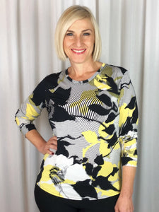 Sophisticated and elegant! Our Long Sleeve Sunshine Top made from a luxurious slinky jersey features a leaf design in black, ivory and buttercup tones. This stylish print looks great on its own or team it with a jacket in a co-ordinating colour to make it pop. Made in Australia from Polyester Spandex it washes and drip dries with no ironing required.