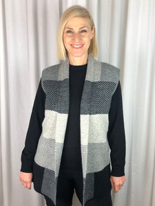 Our Geometric Block Vest is ever so stylish and adds that extra layer of warmth to your winter outfit. In shades of charcoal, oatmeal and black, you'll find it coordinates back with almost everything in your wardrobe. Knitted from a blend of Acrylic, Nylon and Polyester this striking piece is fully washable.