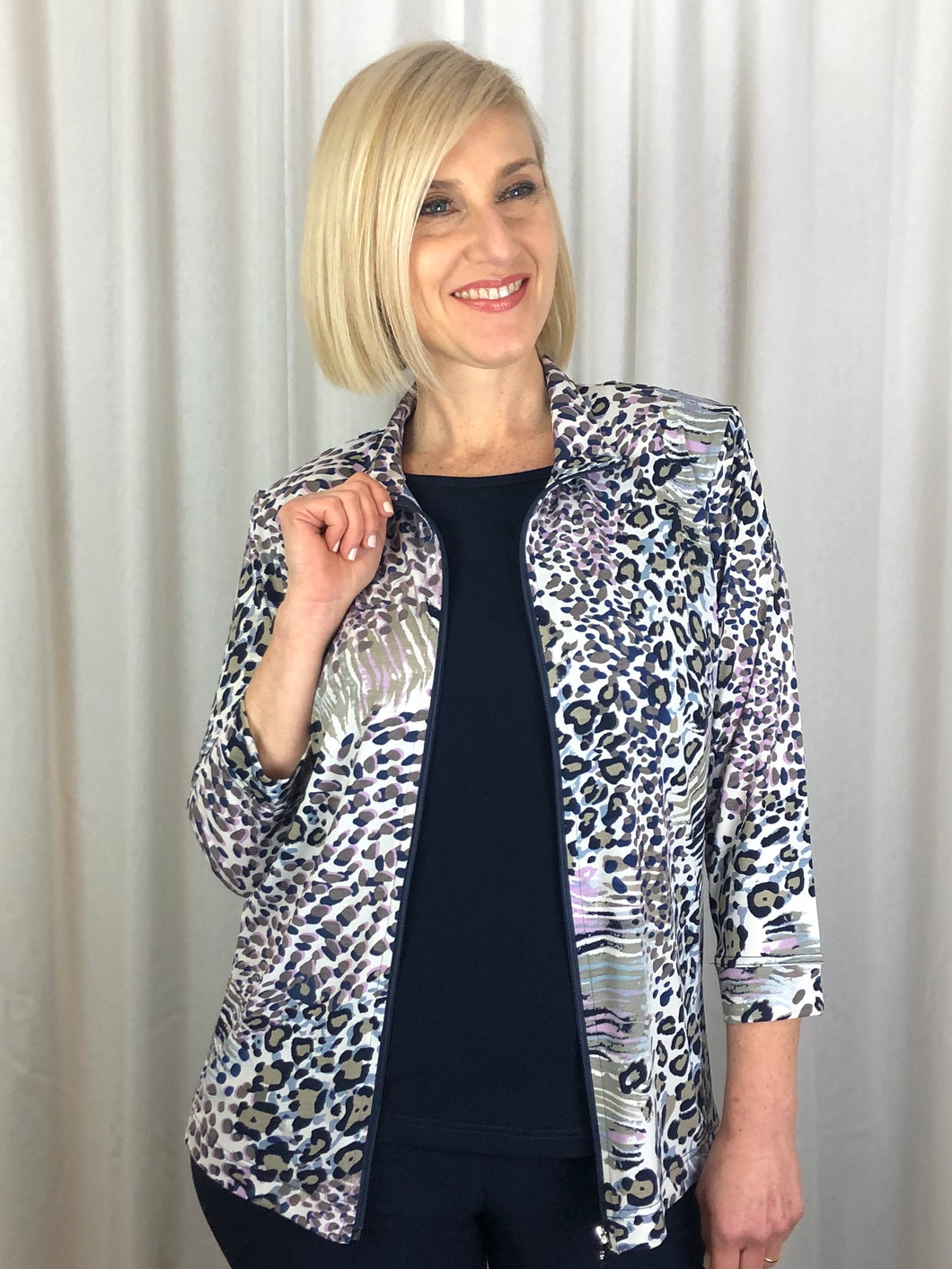 Our 3/4 Sleeve Serengeti Zip Jacket is a relaxed, easy to wear item that packs easily making it great for travelling. In shades of navy, taupe and pink, team it with one of our camis in a coordinating colour to highlight the print. Made in Australia from Poly/Spandex, it's fully washable and drip dries in no time.