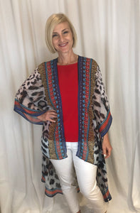 Whether you're travelling somewhere exotic or need something eye-catching, our Amalfi Cape is ideal whatever the occasion. Made from Polyester Georgette this gorgeous cheetah print cape highlighted with a colourful design down the front is adorned with diamantes. Team it with a coordinating Cami and our Diamante Pant to complete the outfit. The only accessory you need is a glass of champagne!