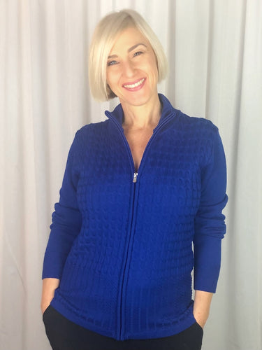 Slade Knitwear is an iconic Australian brand that has been designing and manufacturing quality women's knitwear for over 70 years. This Zip Front Cable Cardigan made from 100% Wool is sporty and stylish for any time of day. You can't go past Slade for winter knitwear.