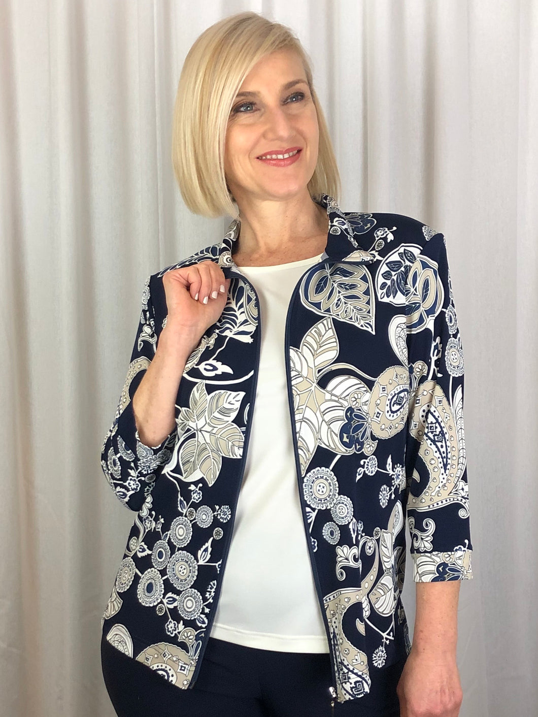 Our 3/4 Sleeve Cotswald Zip Jacket is a relaxed, easy to wear item that packs easily making it great for travelling. Featuring a paisley and floral design in neutral tones with highlights of puff paint on a navy background, the print stands out when teamed with one of our camis in a coordinating colour. Made in Australia from Poly/Spandex, it's fully washable and drip dries in no time.