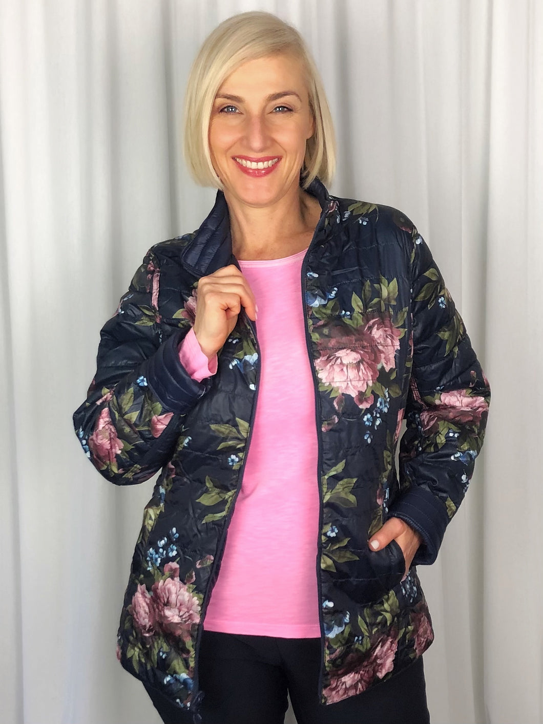 This Reversible Floral Puffer Jacket features double the styling options with a colourful floral design on one side and solid navy on the reverse. It co-ordinates easily with your Autumn/Winter wardrobe by adding a splash of colour underneath. Made from Polyester, it's lightweight and washable.