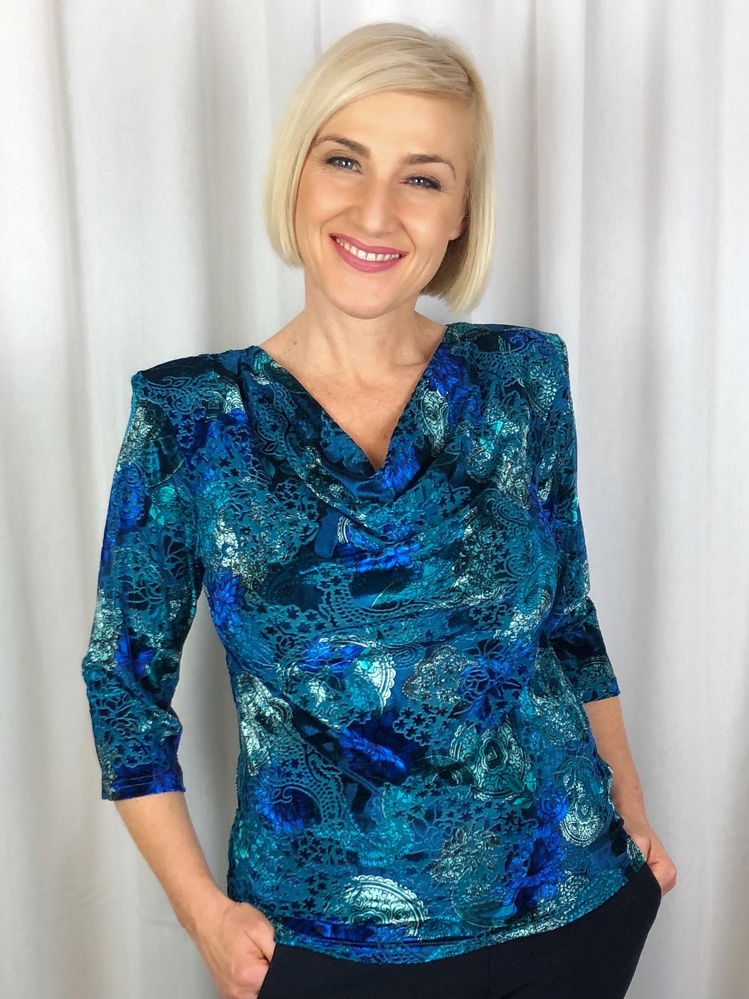 There's nothing more luxurious than the richness of velvet! Made in Australia, our 3/4 Sleeve Terrigal Cowl Neck is sumptuous and elegant for Autumn/Winter. Perfect for a special occasion or and evening out, the burnout velvet print in radiant jewel tones will have you sparkling. Made of Poly/Spandex, it's fully washable and drips dry with no ironing required.