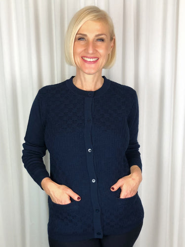 Slade Knitwear is an iconic Australian brand that has been designing and manufacturing quality women's knitwear for over 70 years. Made from 100% Pure Wool this Basket Stitch Cardigan with two pockets is a true classic. You can't go past Slade for winter knitwear.