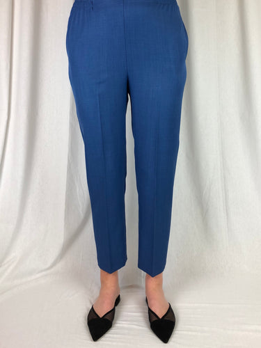 Stretch, Style & Comfort! Our Petite Length Summer Pant by Jillian is one of our most popular styles. Made in Australia from Polyester, these pants have a flat front with elastic sides and back. Featuring side seam pockets this slim legged pant is the perfect length for those ladies who are  tired of always having their pants shortened.