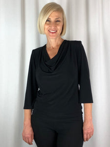 Our Classic Cowl Neck Top has become a staple piece in our stores. Available in a variety of prints and plains it's hard not to love this top. Made in Australia from Poly/Spandex, with it's 3/4 sleeve it's ideal for any time of year, day or night. Easy to care for and ideal for travelling!