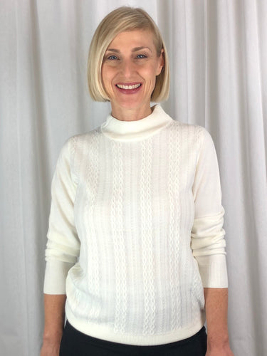 Affordable Luxury! Our Cable Front Turtle Neck Pullover is made from a