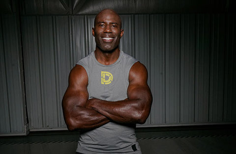 Image of Terrell Davis wearing a DEFY tank top.