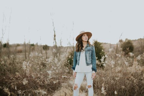 field woman blue jean denim jacket hat