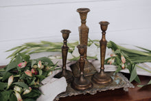Load image into Gallery viewer, Set of 4 Mismatched Solid Darkened Brass Candlesticks