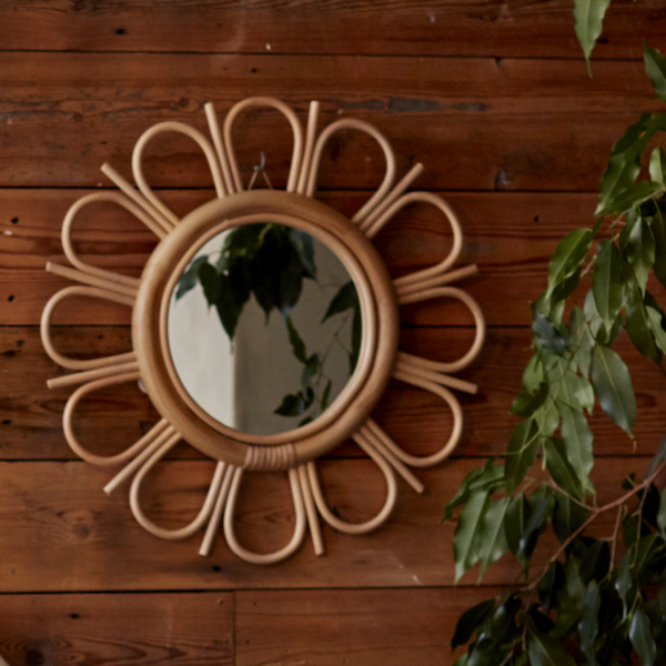 Natural Rattan Sunflower Mirror against Wood Wall- The Rattan Company