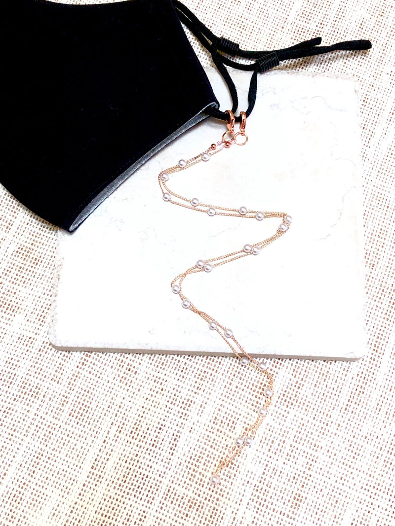 Fancy mask lanyard comes with rose gold and dainty pearl chain shown on a black organic face mask
