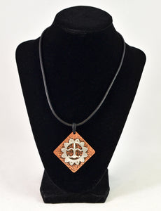 Silver and Copper Pendant on Leather by Christina Chomel