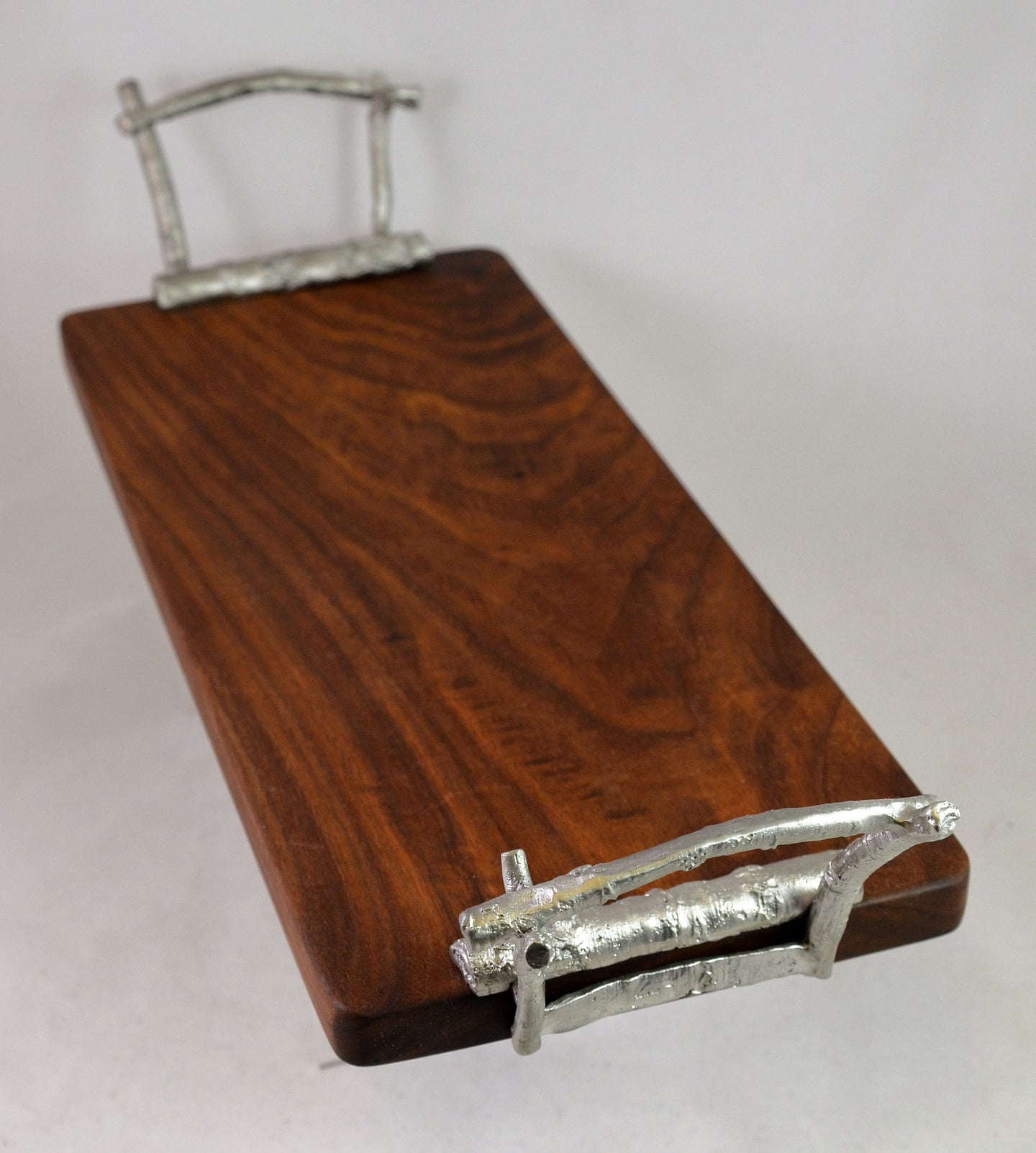 Serving board with silver handles by Michael Michaud